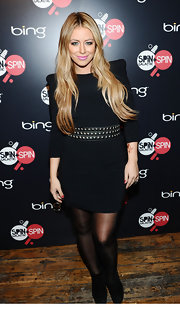 Aubrey donned a little black dress with strong shoulders and a studded belt.