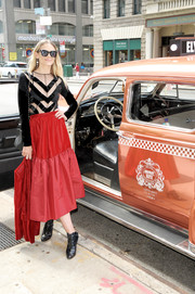 Jaime King chose a red mixed-media midi skirt to pair with her black top.