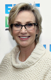 Jane Lynch visited 'The Elvis Duran Z100 Morning Show' wearing this casual side-parted hairstyle.