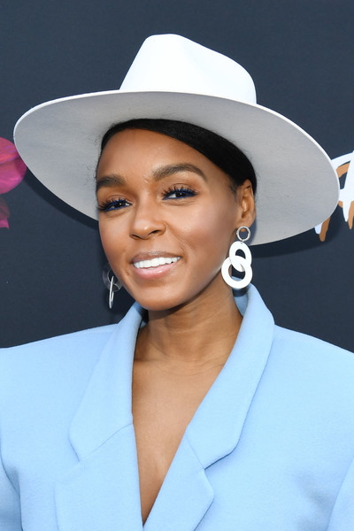 Janelle Monae teamed a white hat with a pastel-blue blazer dress for the Fem the Future brunch.