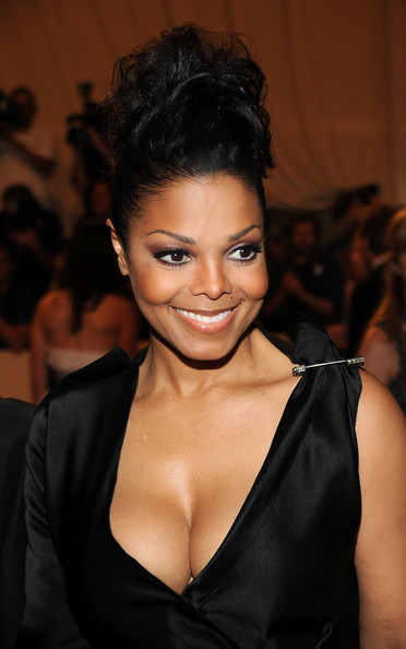 Janet Jackson Messy Updo [american woman: fashioning a national identity,hair,hairstyle,face,eyebrow,lip,beauty,black hair,skin,fashion,chin,janet jackson,arrivals,costume institute gala benefit,metropolitan museum of art,new york city,met gala,opening,exhibition]