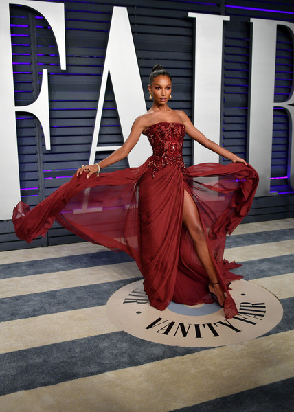 Jasmine Tookes Strapless Dress [oscar party,vanity fair,clothing,dress,gown,fashion model,fashion,red,formal wear,shoulder,haute couture,beauty,beverly hills,california,wallis annenberg center for the performing arts,radhika jones - arrivals,radhika jones,jasmine tookes]
