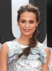 Alicia Vikander styled her hair into a messy-chic segmented ponytail for the European premiere of 'Jason Bourne.'