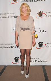 Katherine belted a nude mini pencil skirt for the Compassion Revolution Press Conference.
