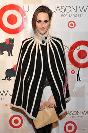 Yelle accented her launch style with a striped sweater capelet.