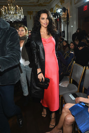Adriana Lima's black Zeynep Arcay leather coat provided an edgy contrast to her delicate dress.