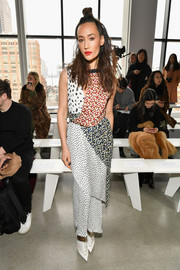Maggie Q sealed off her look with white cutout booties, also by Jason Wu.