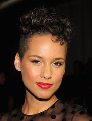Alicia Keys looked cool with her curly fauxhawk at the Jason Wu Spring 2014 show.