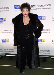 Liza Minnelli went out to see Jay-Z's concert for a cause wearing a floor-length fur coat.
