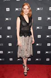 Black Sophia Webster sandals with bedazzled heels polished off Jessica Chastain's look.