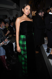 Kat Graham chose a strapless black gown with checkered side panels for the Jean Paul Gaultier Couture show.