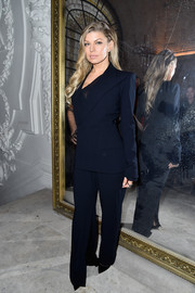 Fergie suited up in this one-sleeve jacket and pants combo by Jean Paul Gaultier Couture for the label's fashion show--definitely not your standard pantsuit!