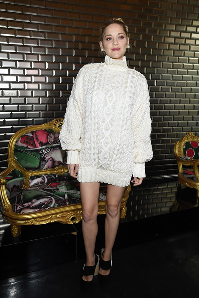 Marion Cotillard attended the Jean Paul Gaultier Couture show rocking an intricate white cable-knit sweater dress from the label.