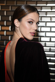 Iris Mittenaere wore her hair in a sleek chignon at the Jean Paul Gaultier Couture show.