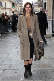 Carine Roitfeld arrived for the Jean Paul Gaultier fashion show wearing a tan tweed coat over a blouse and skirt combo.