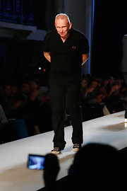 Jean Paul dresses in all black while closing his show during Fashion Week.