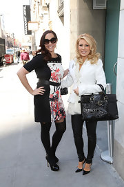 Gretchen Rossi carried a black faux crocodile skin bag while out in NYC.