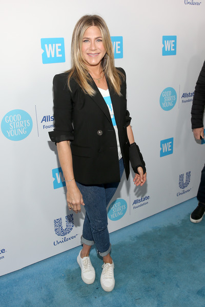 Jennifer Aniston Leather Sneakers [yellow,fashion,footwear,outerwear,electric blue,event,long hair,shoe,carpet,flooring,young people changing the world,jennifer aniston,california,inglewood,the forum,we day]