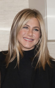 Jennifer Aniston visited the Inova Alexandria Hospital wearing her hair straight and shiny- Her signature blown-out look.