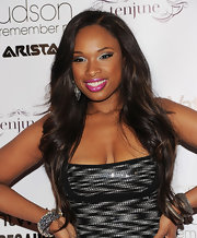 Jennifer Hudson saturated her upper lids with silver shadow and thick liner. A bright pink pout completed her alluring look.