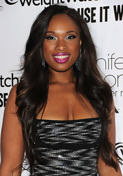 Jennifer Hudson has been on fire lately. At her album release party, she looked sensational in a sequin cocktail dress and matching silver shadow. She amped up her look with a hot pink pout.
