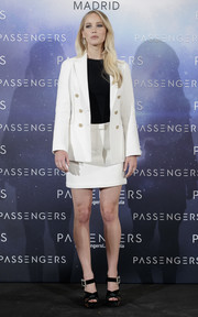 Jennifer Lawrence styled her suit with a pair of crystal-buckled platform sandals by Roger Vivier.