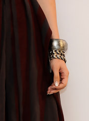 Jennier Lopez outfitted her haltered dress with silver bangle bracelets, which added a bit of edge to her classic look.