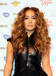 Jennifer Lopez styled her hair in long center part curls that were full of volume and shine.