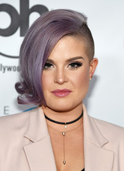 Kelly Osbourne showed off her unique style with this half-shaved hairstyle at the launch of 'Jennifer Lopez: All I Have.'