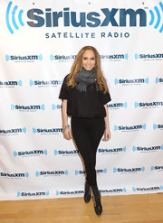 Jennifer Lopez visited Sirius XM in military-inspired black leather mid-calf boots.