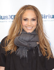 Jennifer stays bundled at the Sirius Studio in a knotted scarf.