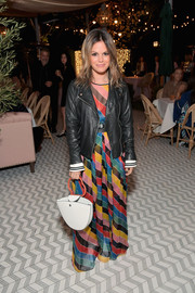 Rachel Bilson layered a rainbow-striped maxi dress by Philosophy di Lorenzo Serafini under a leather biker jacket for the Jennifer Meyer store opening.