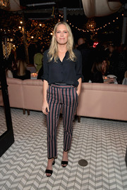 Erin Foster teamed her shirt with a pair of striped pants.