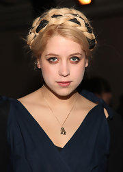 Peaches Geldof added some nice flare to her grecian braid. She intertwined black fabric in her braided bun for a funky twist on a traditional hairstyle.