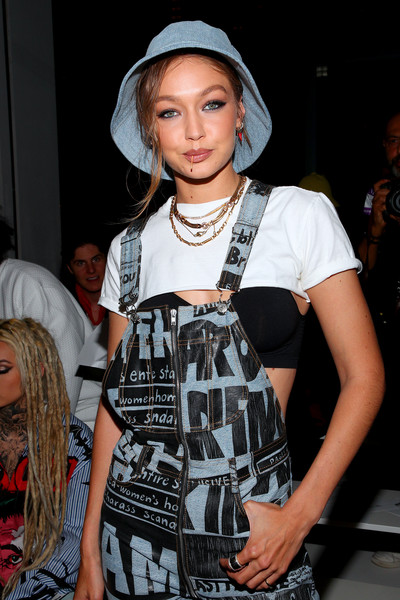 Gigi Hadid arrived for the Jeremy Scott fashion show wearing a denim bucket hat by Lack of Color.
