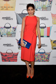 Frieda Pinto's dazzling royal blue clutch elevated her look with a pop of color to complement her dress