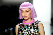 Gigi Hadid rocked a pink bob wig while walking the Jeremy Scott runway.