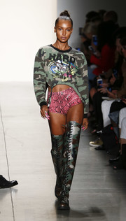 Thigh-high camo-print boots rounded out Jasmine Tookes' eclectic ensemble.