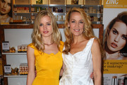 Model Georgia May Jagger (L) and her mother Jerry Hall attend the launch of Invisible Zinc's UV Silk Shield at Myer on November 3, 2010 in Melbourne, Australia.