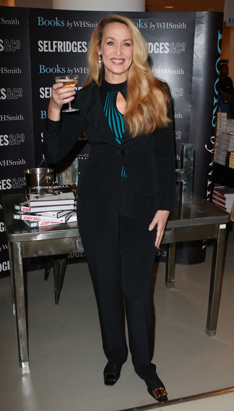 Jerry wears a chic fitted blazer and black pants for her book signing.