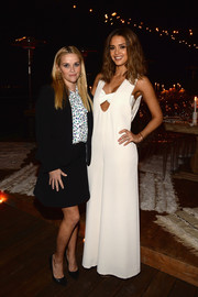 Jessica Alba got into a '70s mood in a super-flared white jumpsuit for the launch of the #letsbehonest campaign.