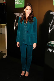 Jessica channeled the '70s in a velvet emerald pantsuit for the Revlon launch at Walgreens. The ascot blouse and slim fitting suit was both sophisticated and playful.