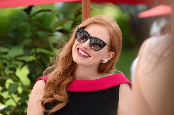 Jessica Chastain Cateye Sunglasses [the hollywood reporter,eyewear,sunglasses,hair,face,glasses,facial expression,pink,beauty,lip,lady,reporter,jessica chastain,grey goose terrace,hollywood,cannes,france,directv,cannes film festival,cocktail party]