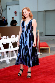 Jessica Chastain looked summery in a sleeveless print dress by J. Mendel during her hand and footprint ceremony.