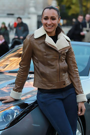 Jessica Ennis kept warm in style with a tan leather bomber jacket during her Jaguar photocall.