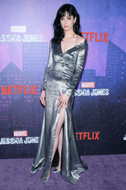 Krysten Ritter was a shimmering standout in a silver Cushnie et Ochs gown with an asymmetrical neckline and a high side slit at the New York premiere of 'Jessica Jones' season 2.