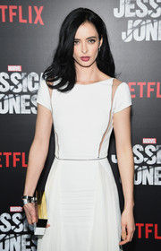 Krysten Ritter is alluring with a side-parted medium layered cut to complete her look