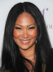 Kimora Lee Simmons flashed her lengthy lashes at the camera at the launch of 'Just Fabulous.'