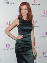 Marcia Cross accented her sophisticated look with a gold hard case clutch etched with black.