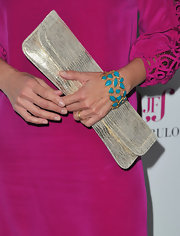 Nia Vardalos added a contrast to her vibrant pink dress with a turqouise gemstone bracelet.